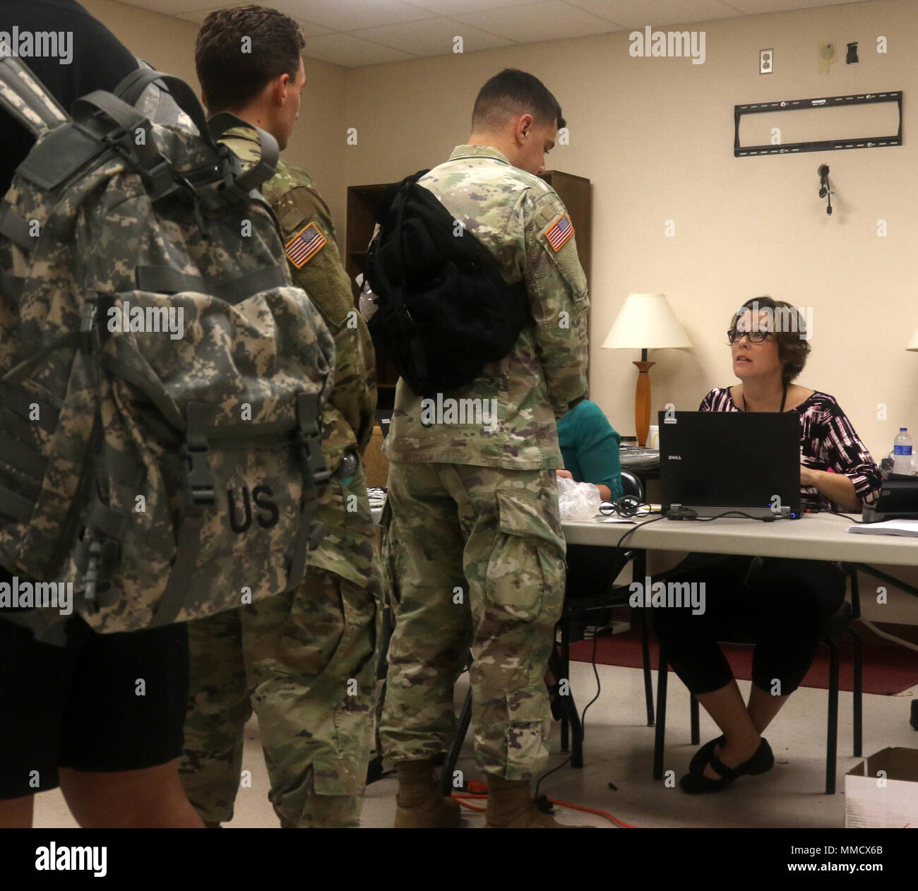 Soldiers of the Mississippi Army National Guard stand in line to start their Periodic Health Assessment October 15, 2017, at Camp Shelby, Mississippi. The PHA is an annual assessment that has to be completed by each Soldier that addresses unresolved health concerns and then either creates a treatment plan or treats the issue on the spot to maintain readiness. (Mississippi National Guard photo by Pfc. Jarvis Mace, 102d Public Affairs Detachment) - Stock Image