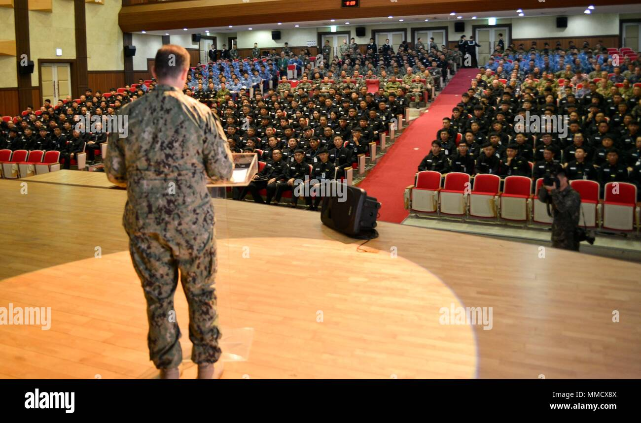 171012-N-TB148-054 BUSAN, Republic of Korea (Oct. 12, 2017) Rear Adm. Brad Cooper, commander, U.S. Naval Forces Korea (CNFK), addresses military members from U.S., Republic of Korea (ROK), and United Nations Command (UNC) Sending States (SS) forces at the fourth annual Mine Countermeasures (MCM) Symposium. The symposium's purpose is to enhance interoperability, coordination and training in mine countermeasures capabilities between U.S., ROK, and UNC SS forces. (U.S. Navy photo by Mass Communication Specialist Seaman William Carlisle) Stock Photo