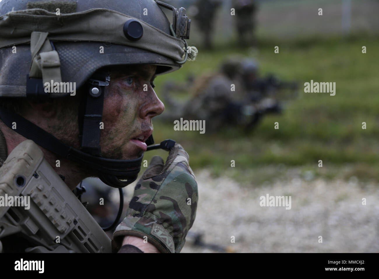 A Dutch Soldier With The Royal Netherlands Army Transmits Situation Report While Conducting Simulated Air Assault Mission During Exercise Swift Response