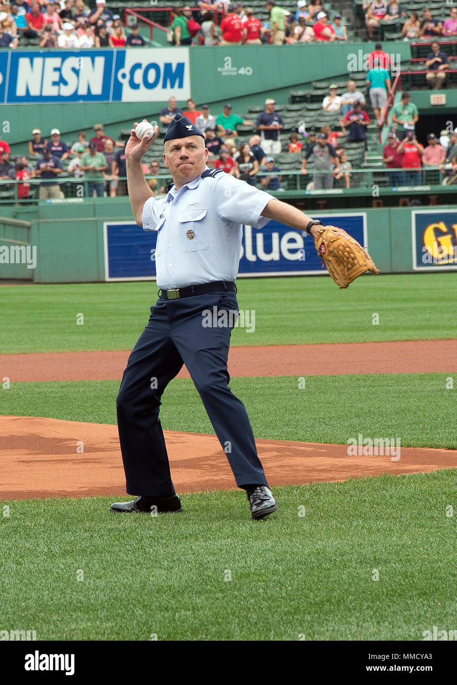 Col. Roman L. Hund, installation commander, throws the first pitch prior to a Boston Red Sox game at Fenway Park in Boston Sept. 14. Local service members were provided tickets to the game as part of the 'Tickets for Troops' program, in which season ticket holders donated their game tickets to active duty military members. (U.S. Air Force photo by Mark Herlihy) - Stock Image