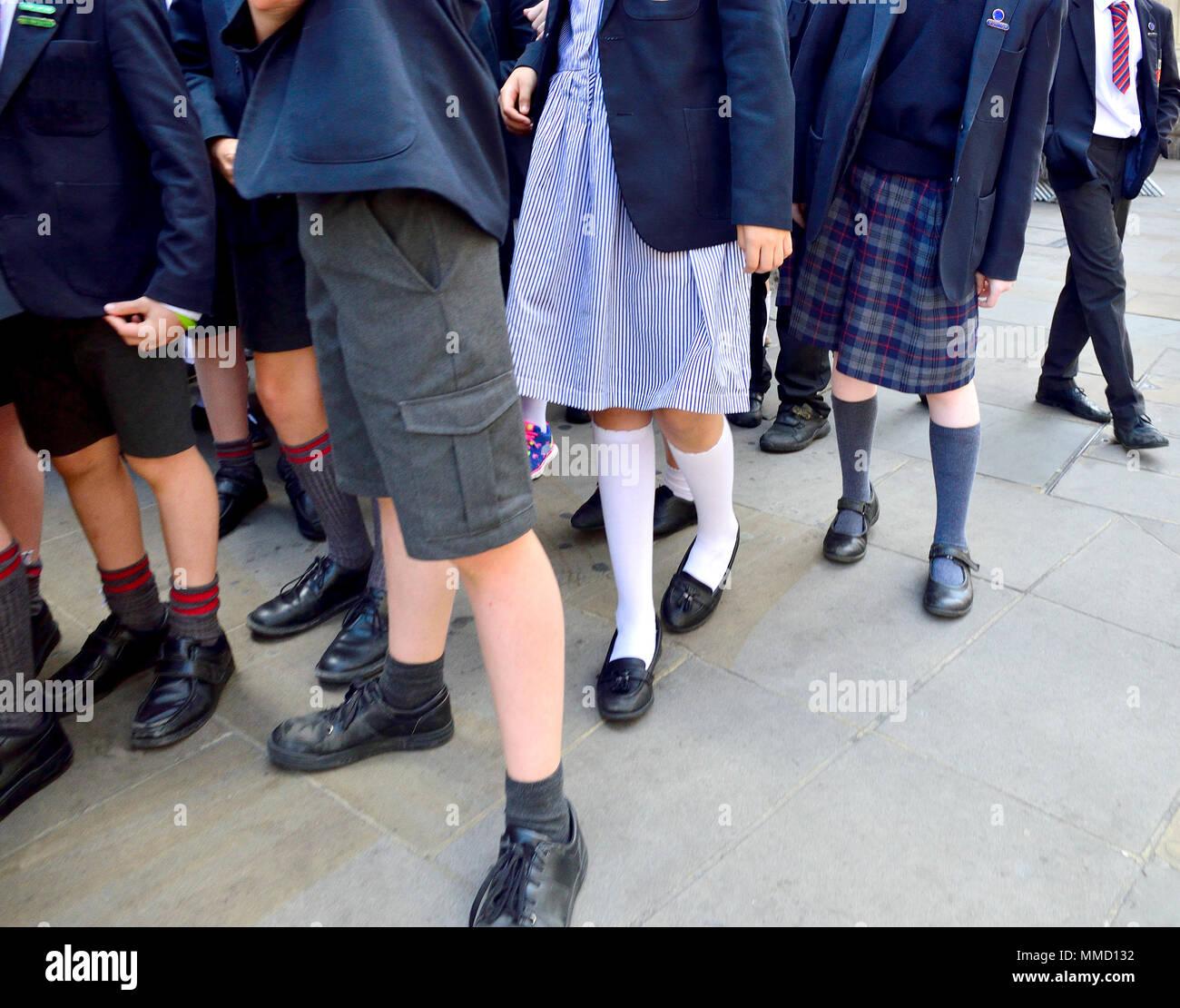 London,England, UK. Primary school children in uniform - anonymous feet and legs - Stock Image