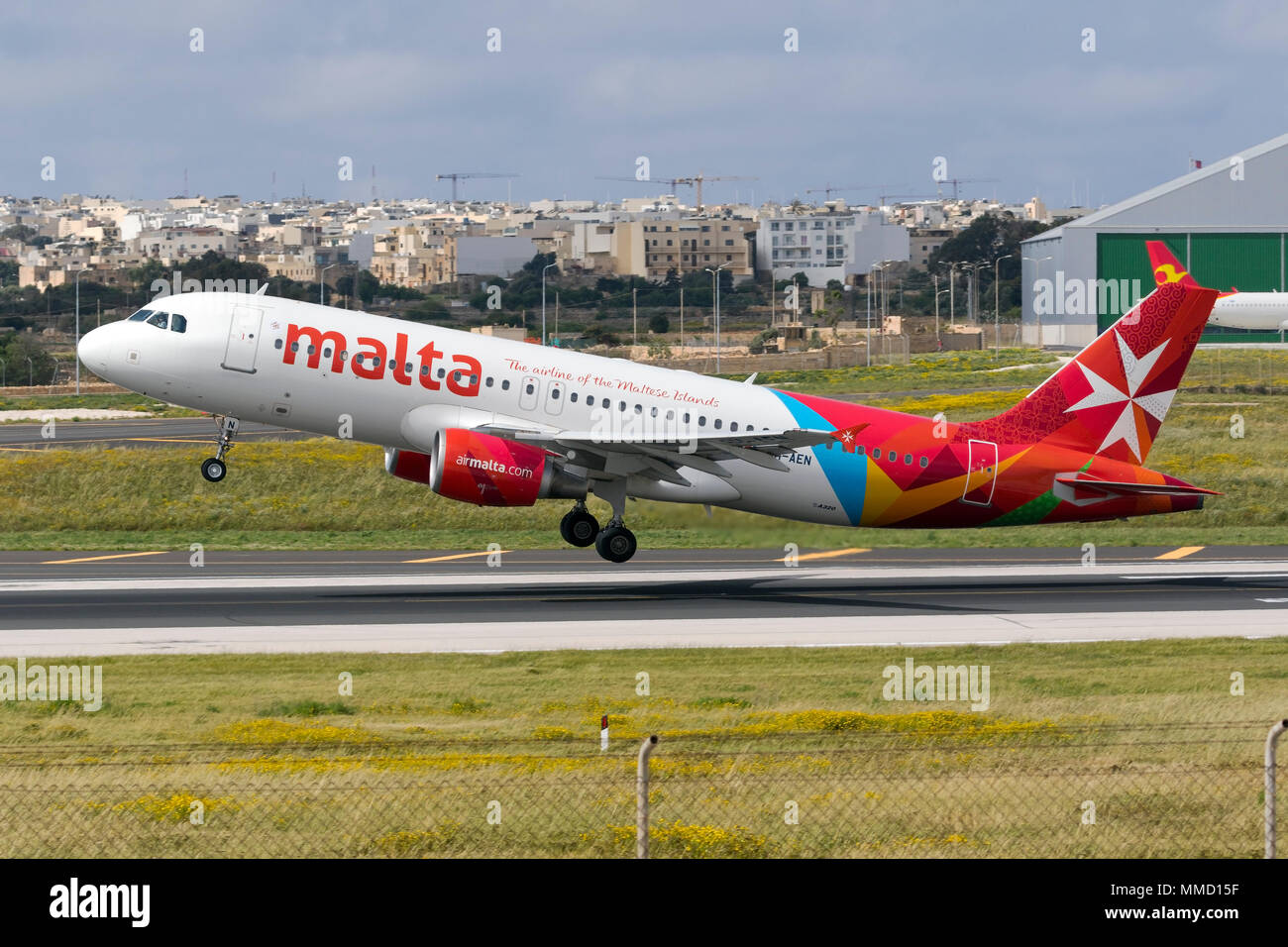 Luqa, Malta April 8, 2018: Air Malta Airbus A320-214 on take off from runway 13. Stock Photo