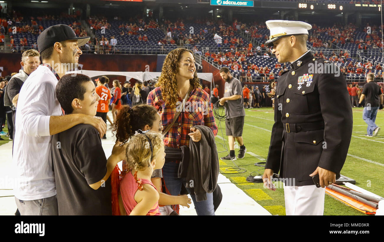 U.S. Marine Corps Maj. Jared Reddinger, Commanding Officer Recruiting Station San Diego, socializes with a family during the San Diego State University (SDSU) vs Boise State University (BSU) football game at the San Diego County Credit Union Stadium, San Diego, Calif., Oct. 14, 2017. BSU defeated San Diego State University, 31-14. (U.S. Marine Corps imagery by Lance Cpl. Jesus McCloud) - Stock Image