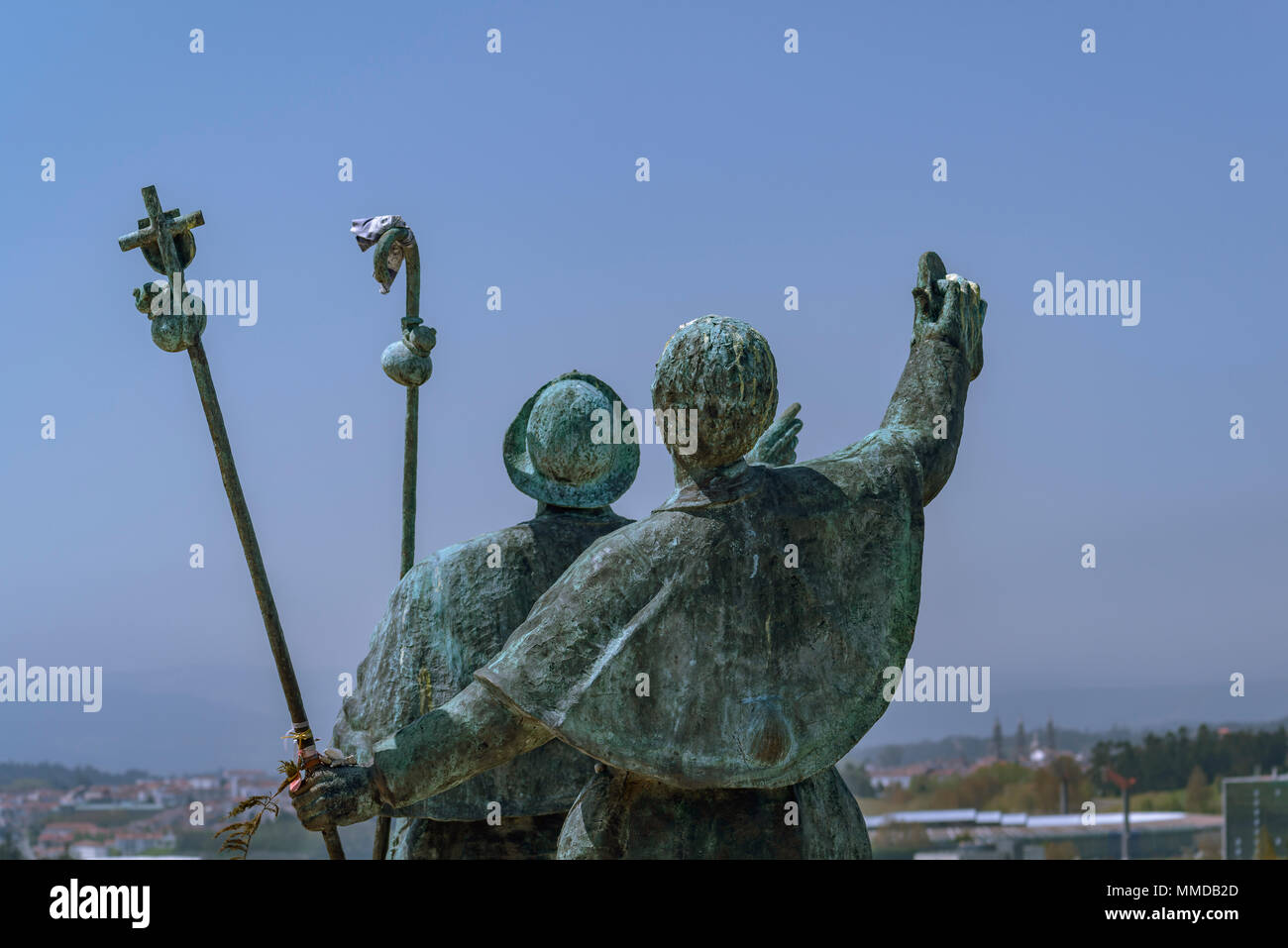 Sculpture of two pilgrims happy to see Santiago de Compostela from the Monte do Gozo at the end of The Way of St James - Stock Image
