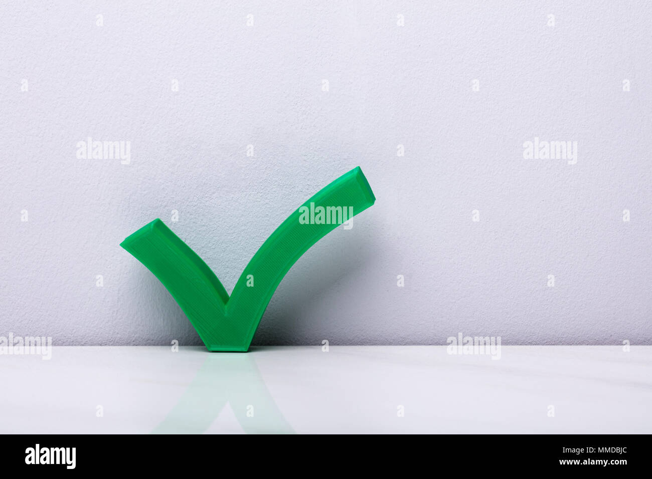 3d Green Check Mark Icon In Front Of Wall Stock Photo 184691316 Alamy