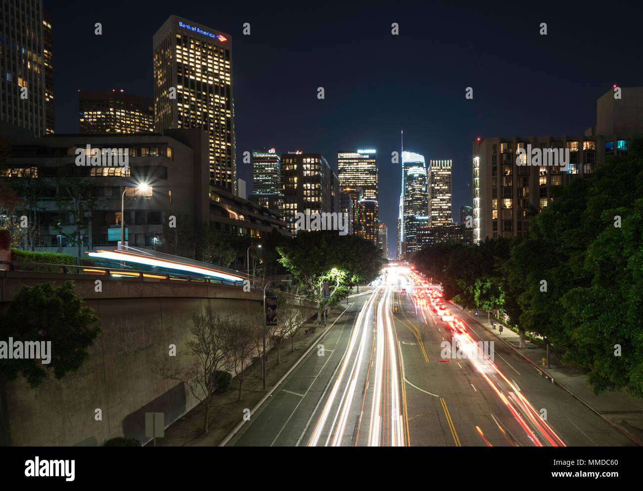 Downtown Los Angeles night traffic , long exposure with light trails through downtown streets - Stock Image