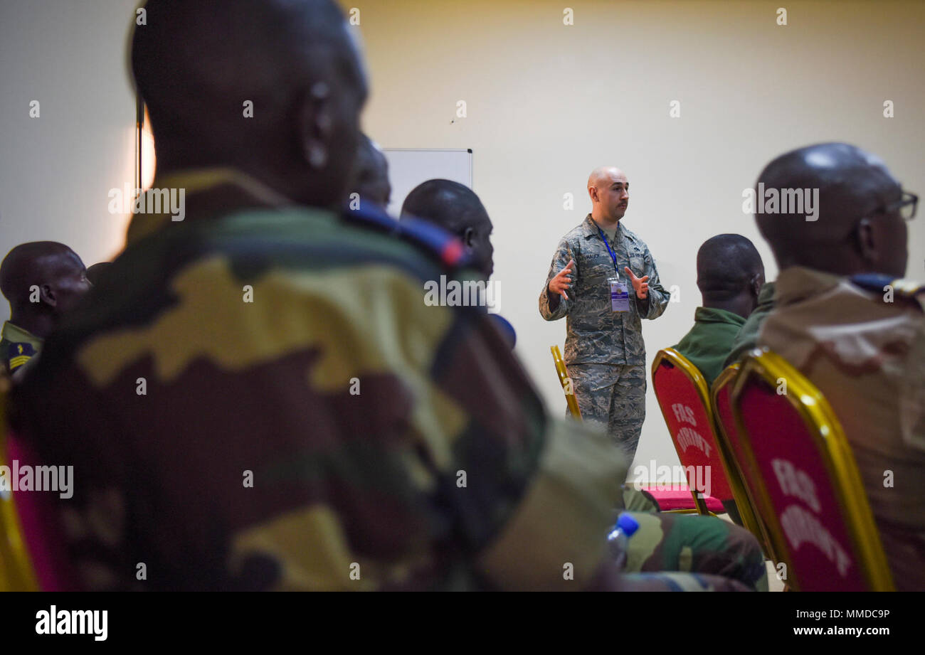 Chief Master Sgt. Ken Hauck, 48th Fighter Wing staff agencies superintendent, answers questions during an air and ground safety group discussion during African Partnership Flight Senegal at Captain Andalla Cissé Air Base, Senegal, March 20, 2018. APF Senegal involves approximately 40 U.S. Airmen from U.S. Air Forces in Europe and Air Forces Africa, the West Virginia Air National Guard, the 818th Mobility Support Advisory Squadron, and the Language Enabled Airman Program. (U.S. Air Force - Stock Image