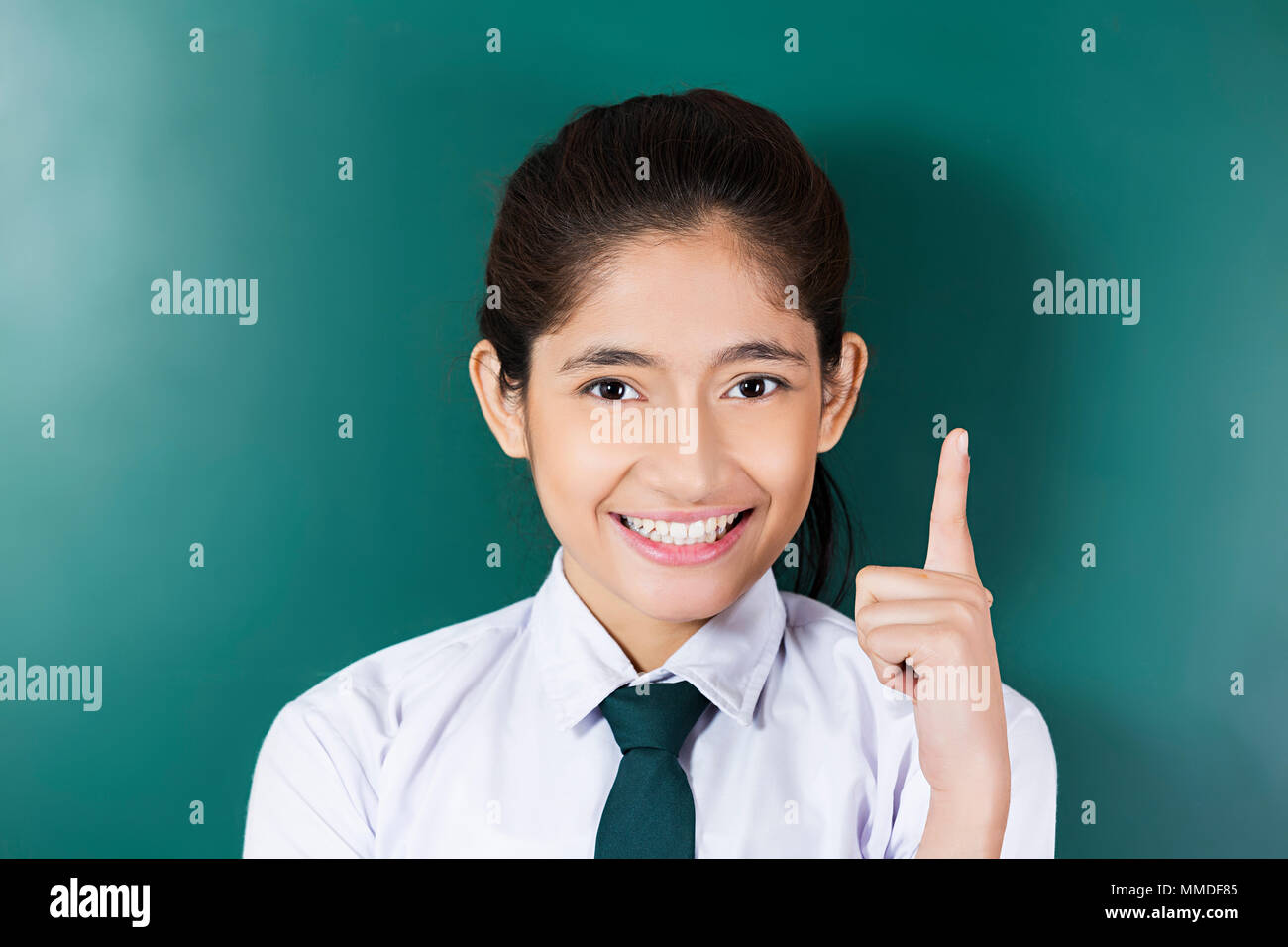 Happy One Teenage School Girl Student Finger Pointing Clicking Class - Stock Image