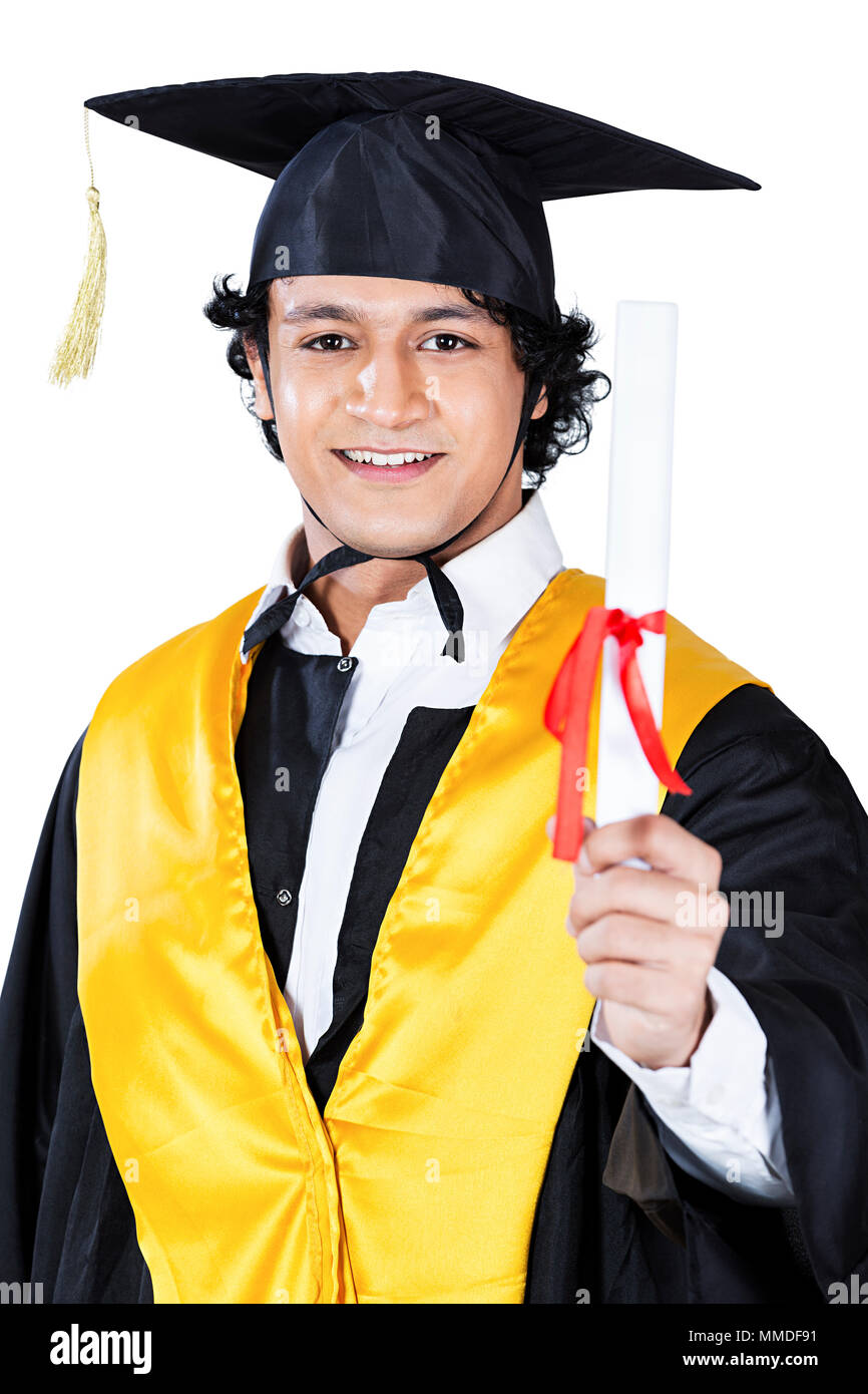 d27ef6e3e5 College Boy student graduation gown and Convocation-Cap Holding Diploma- certificate - Stock Image