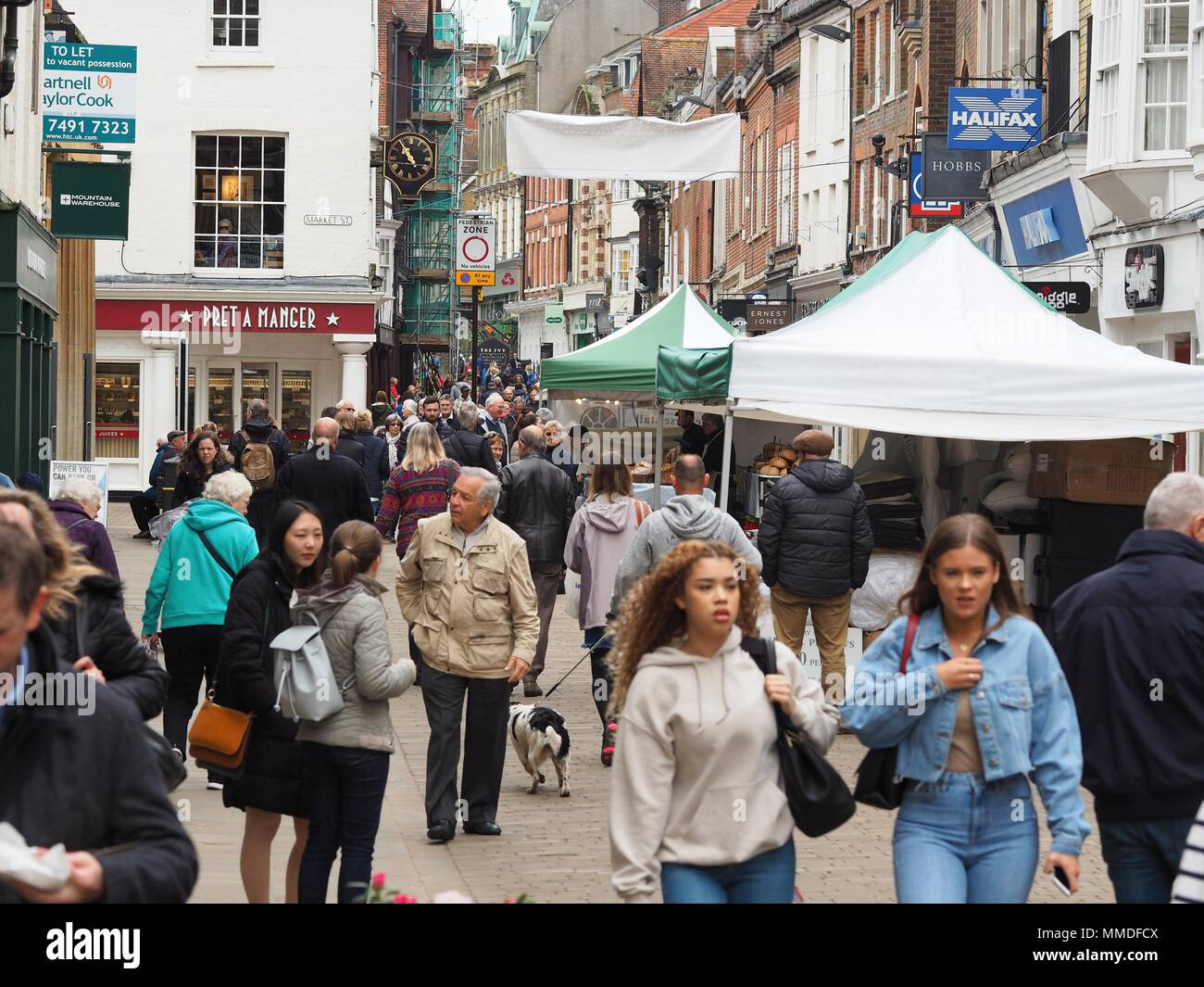 Winchester High Street with shoppers and street traders - Stock Image