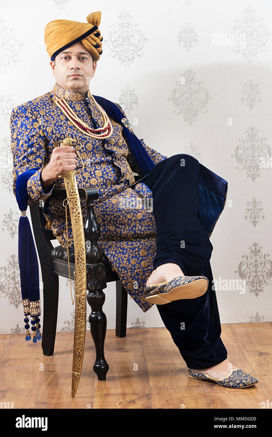 842c122461 One Rajasthani Royal -Groom Sittng Chair Style Wedding Sherwani With Sword
