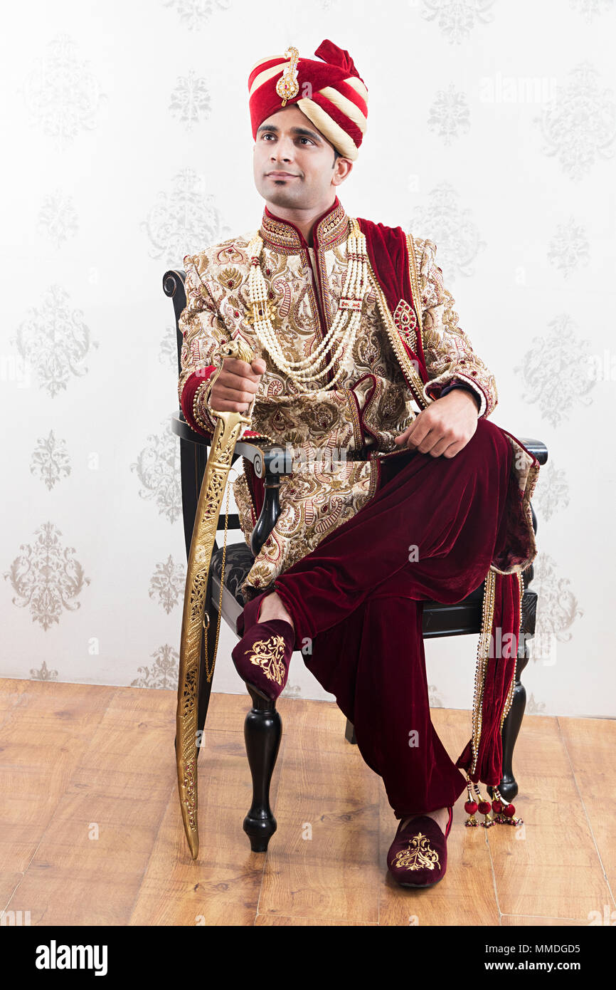 61398c43da One Royal Rajasthani groom sitting Chair traditional wedding Sherwani  Think-Memory