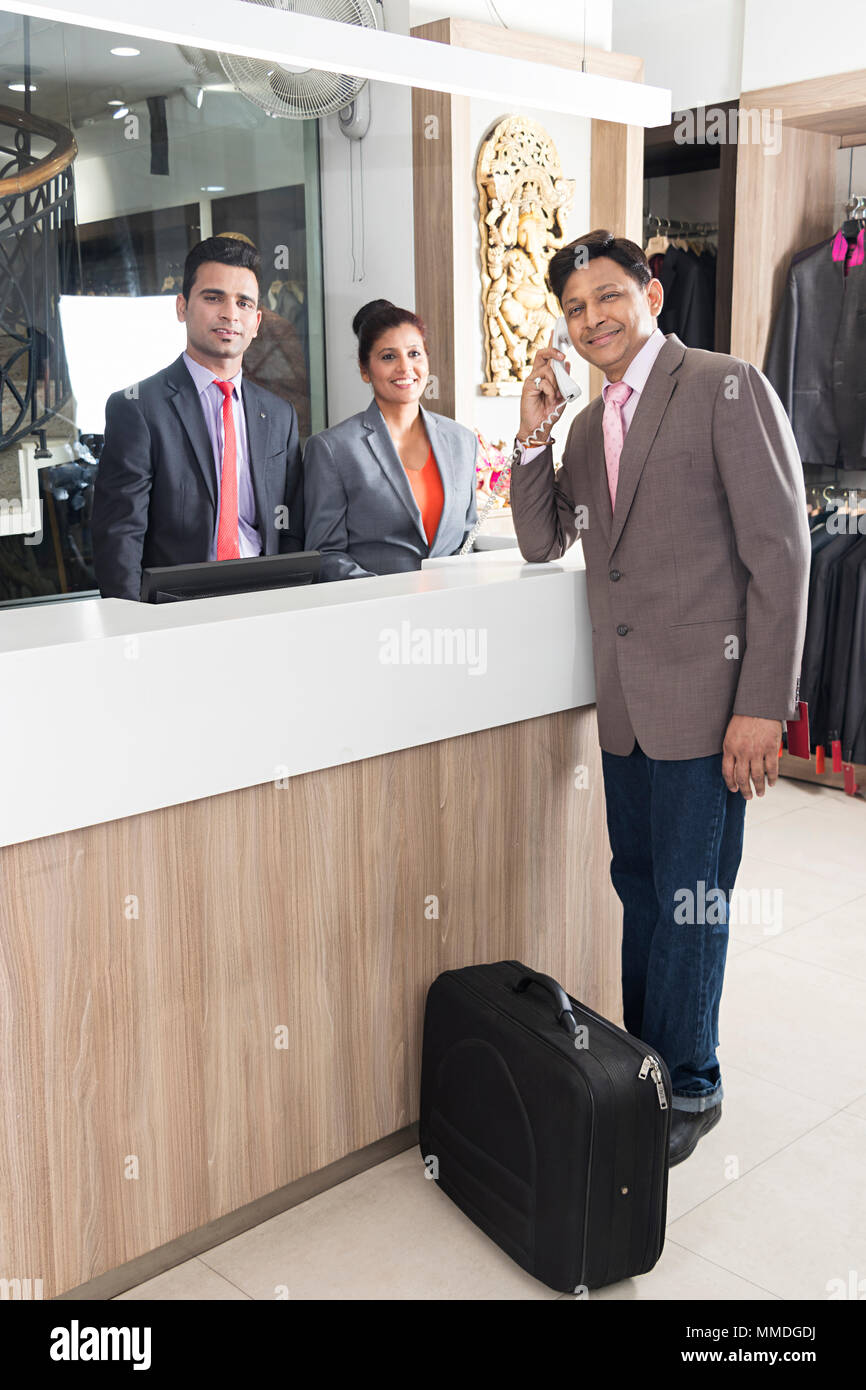 Businessman Arrive Hotel Checkin And Talking Telephone Receptionist Reception Booking-Resort - Stock Image