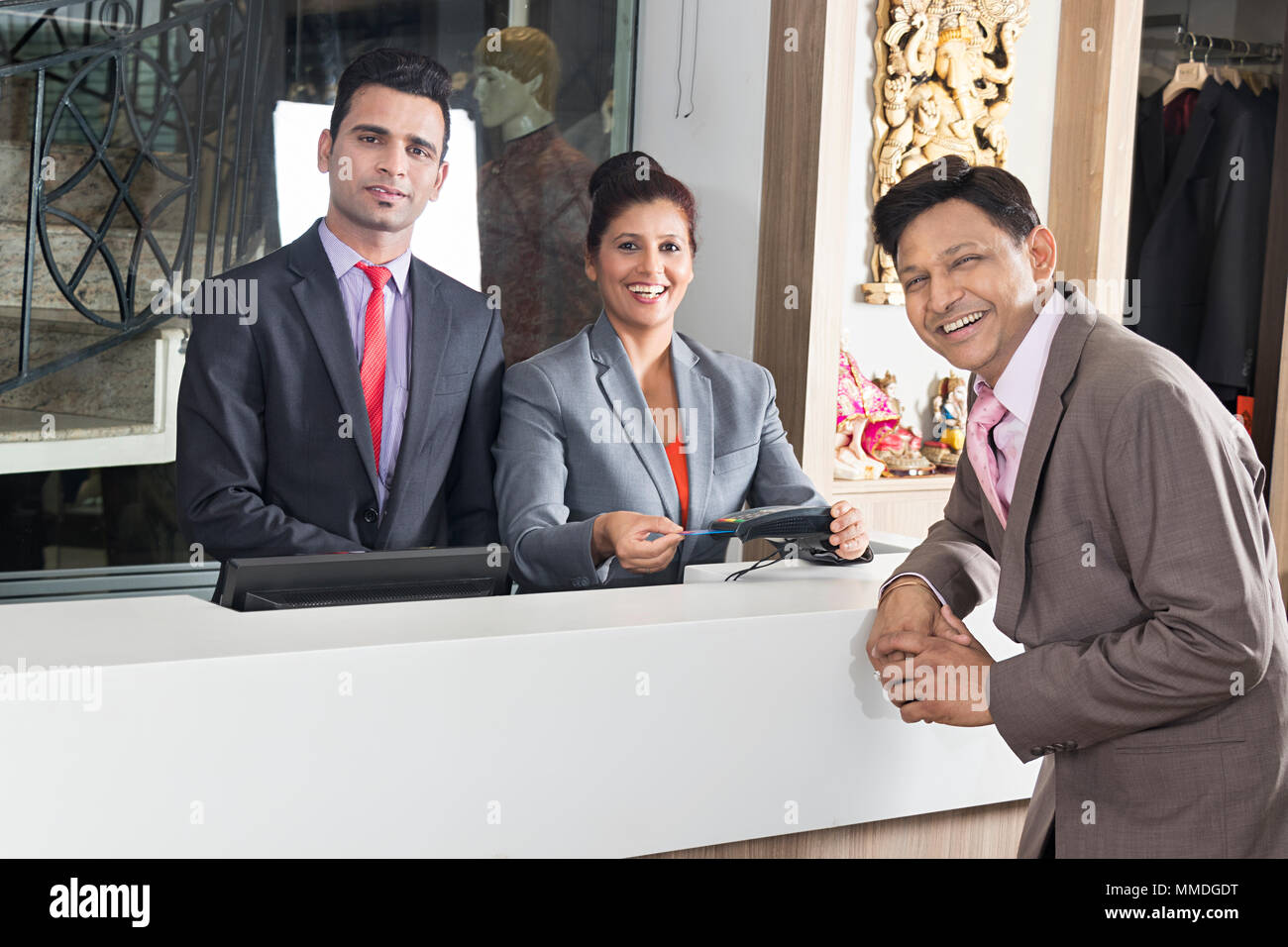 Tourism Man Hotel Pay Room Debit-Card Woman Receptionist Reception Counter - Stock Image