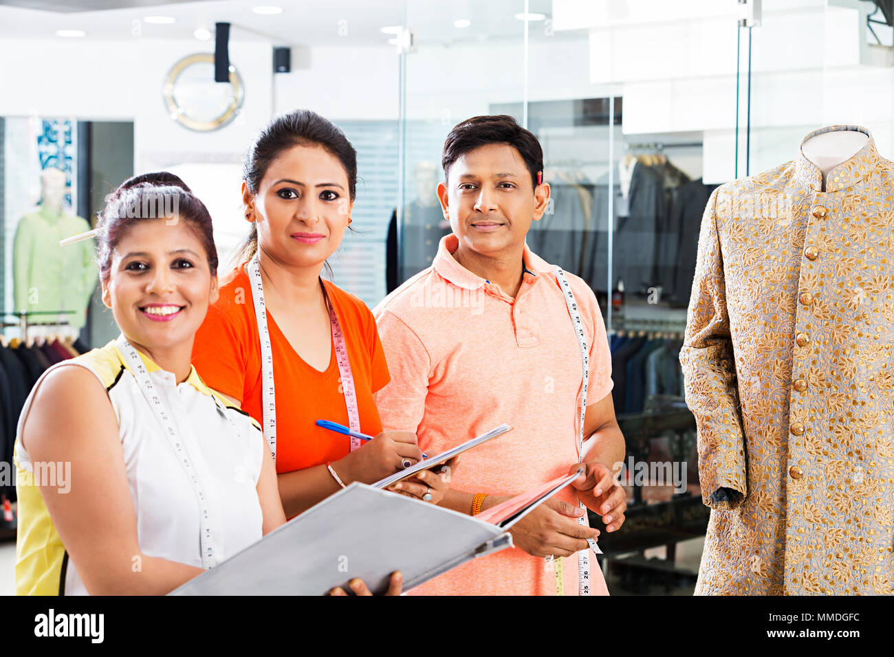 Three Boutique Tailors Teamwork Dress Designer Working In Clothes Shop Stock Photo Alamy