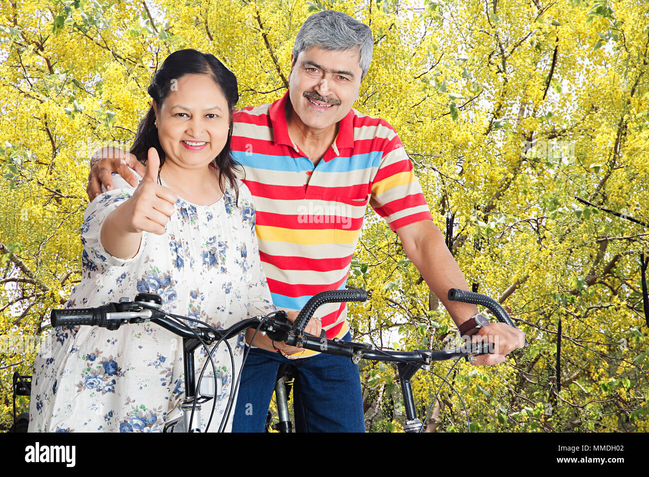 Happy Senior Couple Sitting Cycle And Showing Thumbs Up Enjoy At