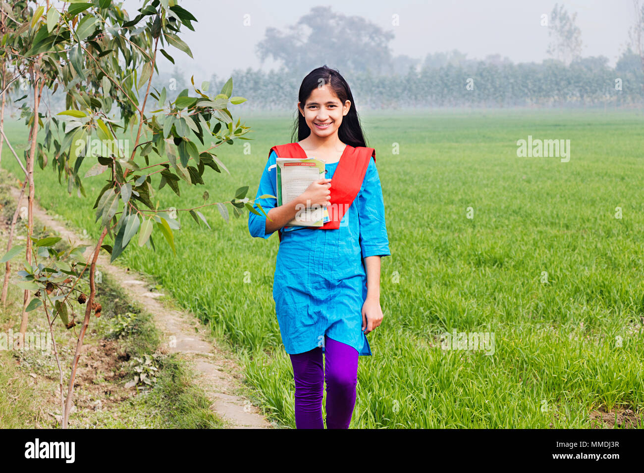 Rural Villager Teenage Girl College Student Holding Books Walking In Farm Stock Image