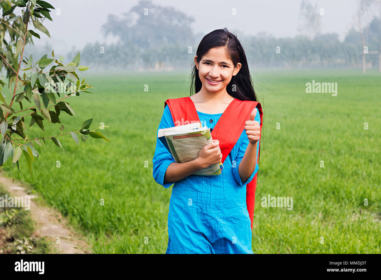 One High School Girl Student Showing Thumbs Up Success Farm Rural Village Stock