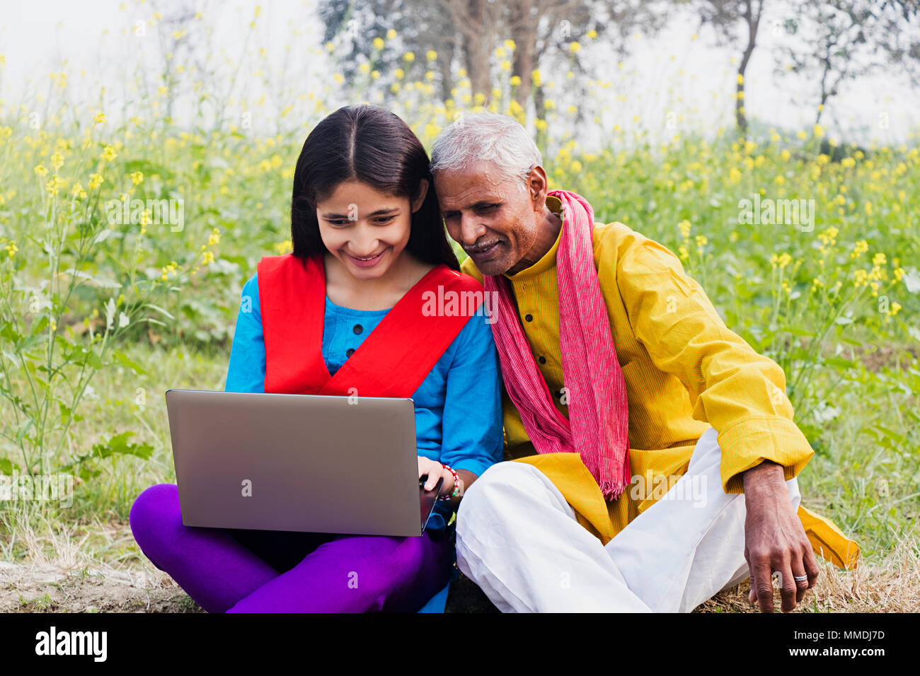 Rural Villager, Grandfather And Granddaughter Sitting Farm laptop ...