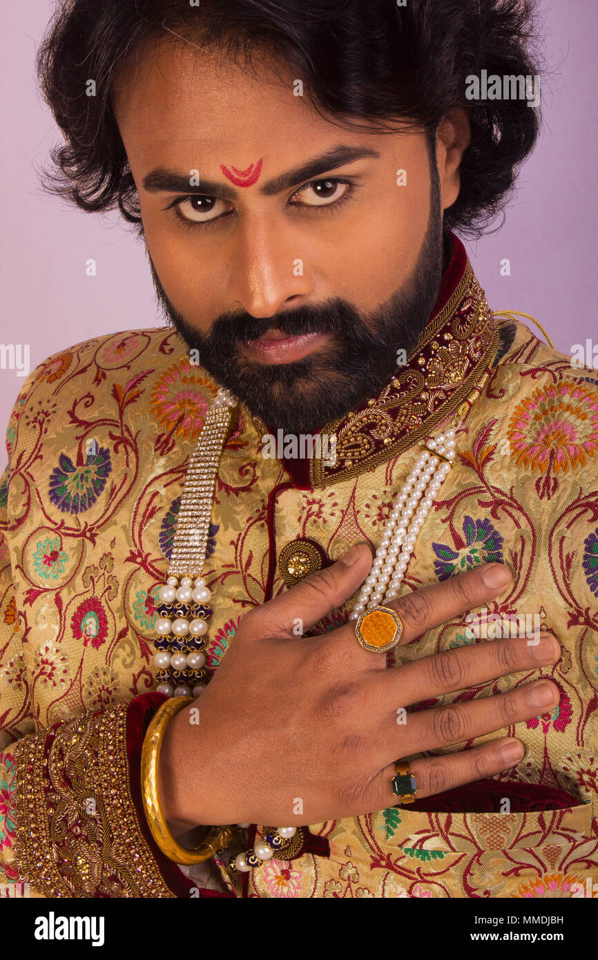 Close up of young handsome man with Indian attire - Stock Image