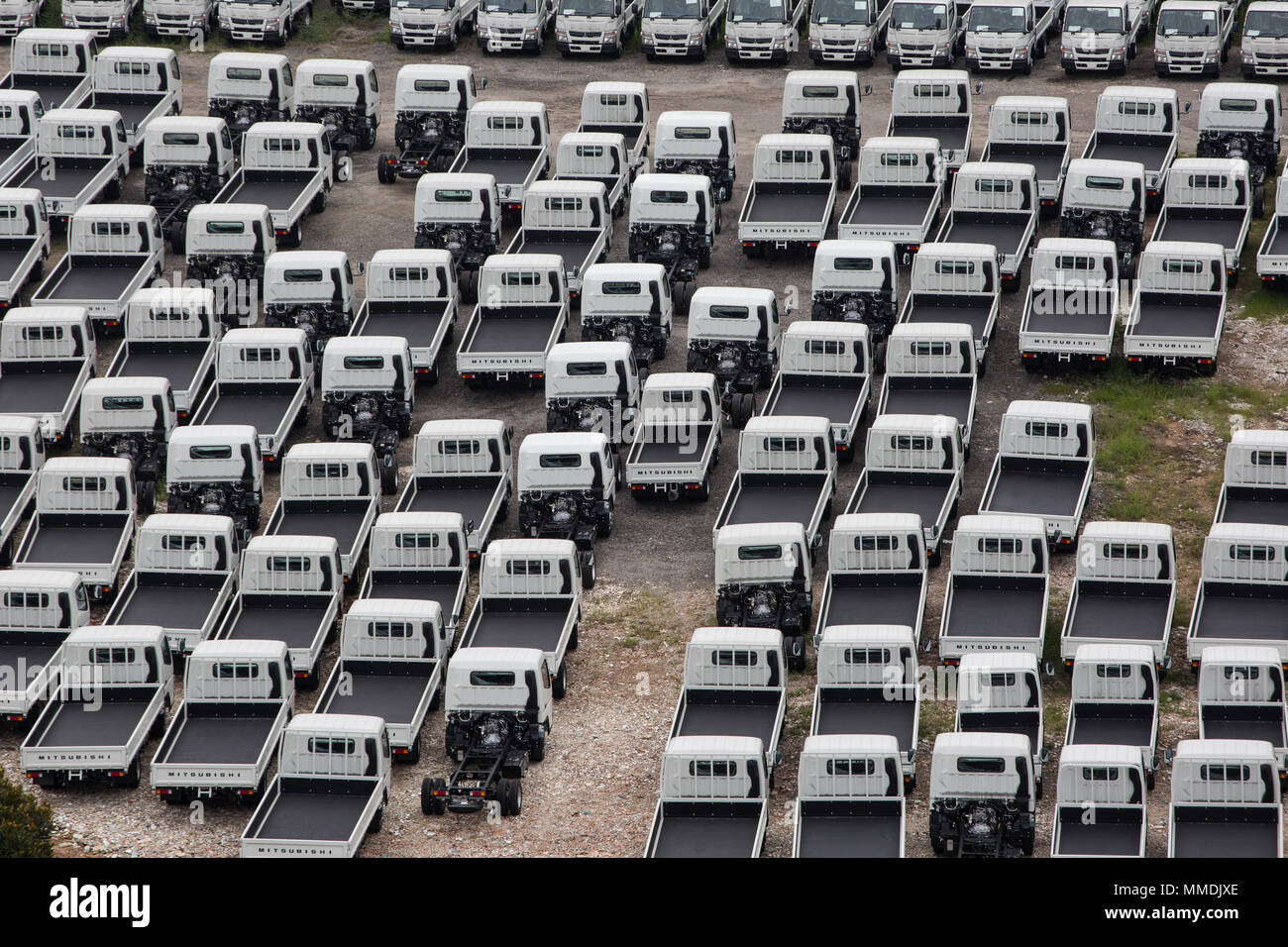 An aerial or drone view of multiple industrial light vehicles parked. Stock Photo