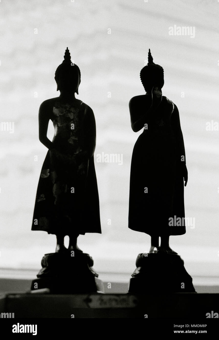 Silhouette figures at Wat Rakhang Bell Temple in Bangkok in Thailand in Southeast Asia Far East. Sculpture Carving Silhouetted Travel B&W - Stock Image