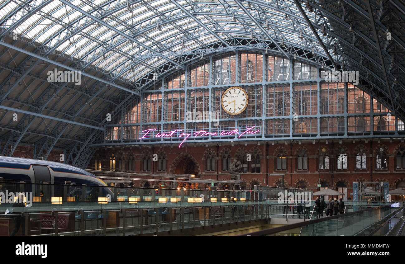 Tracey Emin Unveils 2018 Terrace Wires art commission. Depicting the words, 'I Want My Time With You' in Emin's signature handwriting, the light installation is suspended above the Grand Terrace beneath the DENT London clock, hanging on wires from the station's Grade 1 listed Barlow shed roof. At 20 meters long, the artwork is the largest text piece ever made by the artist and will remain on display until the end of the year.  Featuring: Atmosphere Where: London, United Kingdom When: 10 Apr 2018 Credit: Phil Lewis/WENN.com Stock Photo