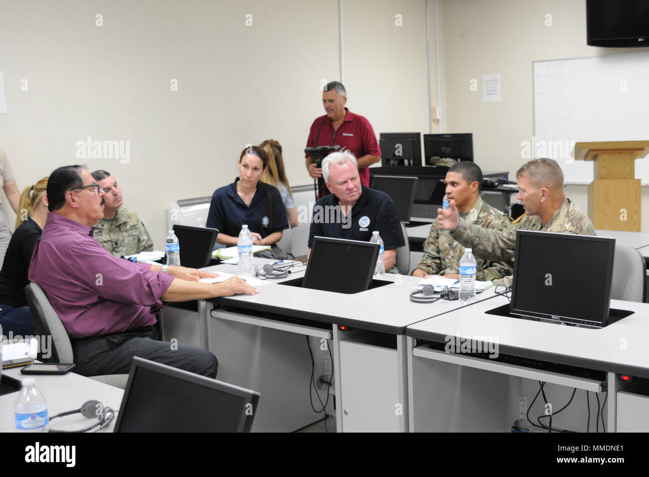 Lt. Gen. Jeffrey S. Buchanan, Commander, U.S. Army North, and officials from the Federal Emergency Management Agency met with officials from the municipality of Mayaguez to discuss the ongoing relief efforts in Puerto Rico, Oct. 20, 2017. (U.S. Army National Guard photo by Staff Sgt. Armando Vasquez/Released) - Stock Image