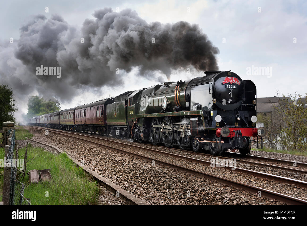Restored Merchant Navy Class locomotive British India Line steams through Settle, North Yorkshire, with The Dalesman special train, 8th May 2018 - Stock Image