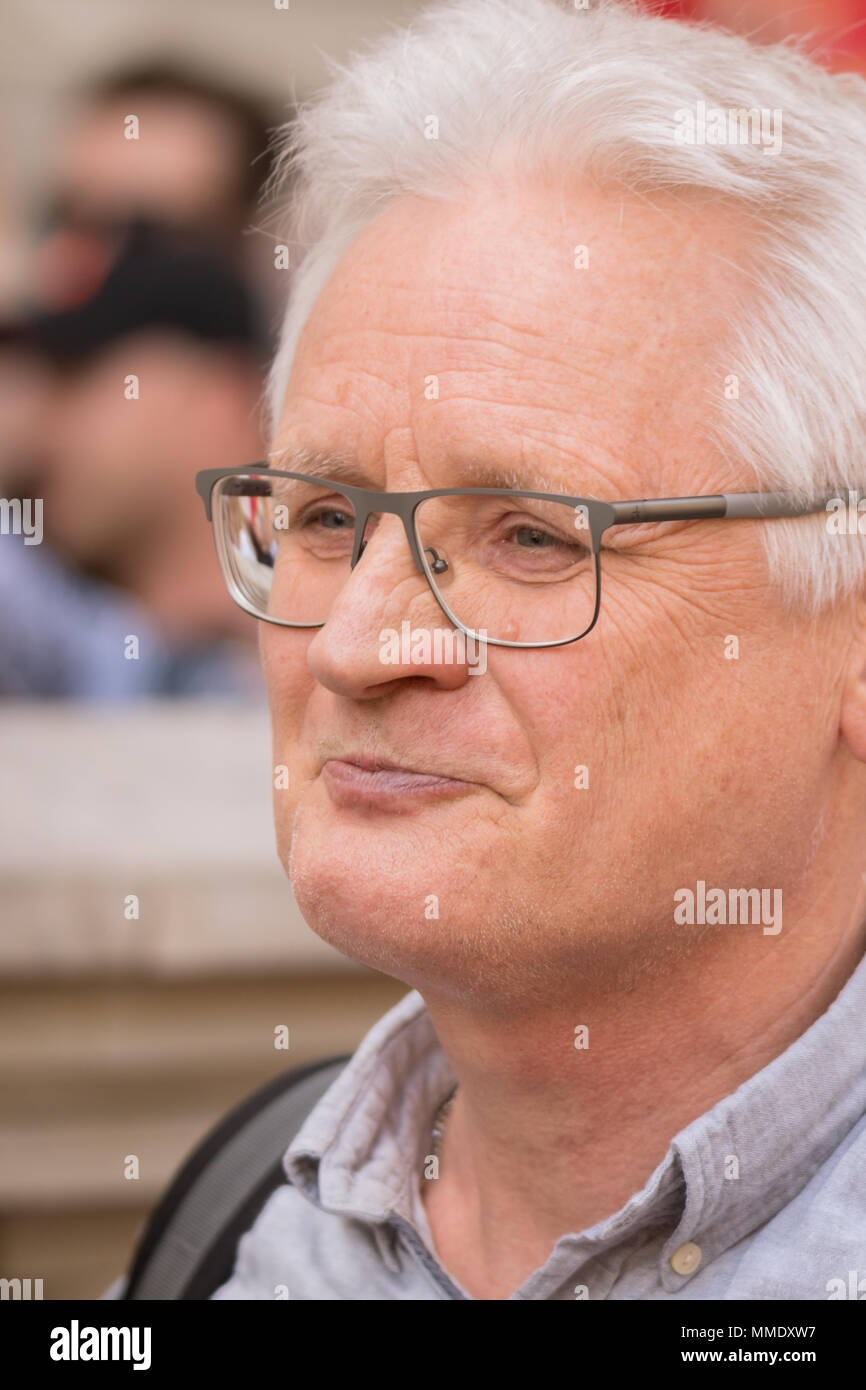 A Man With Glasses Watching The Victory Day Parade In Westminster, London - Stock Image