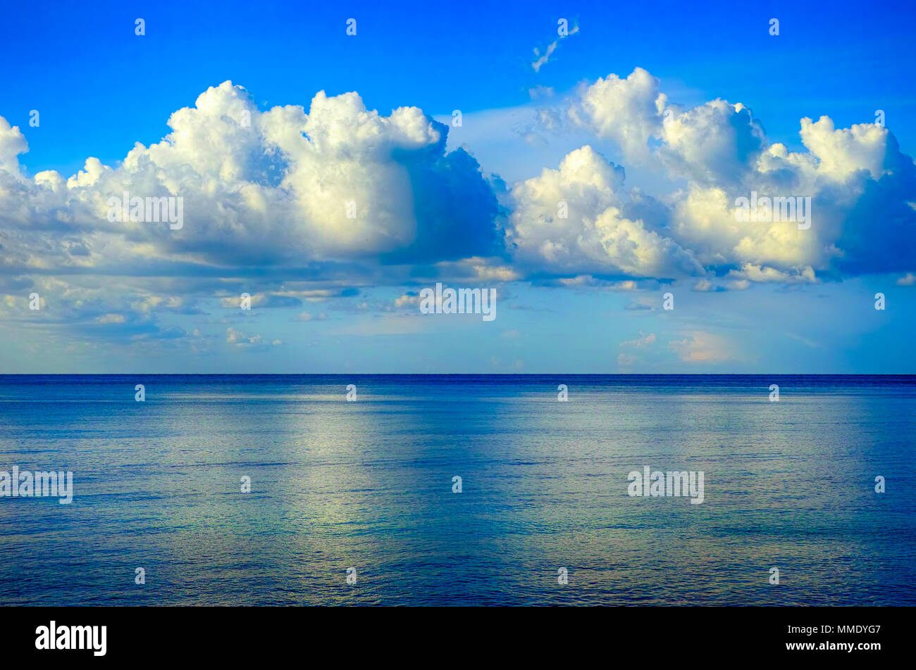 Blue sky with beautiful clouds over the sea. Non-urban scene. - Stock Image