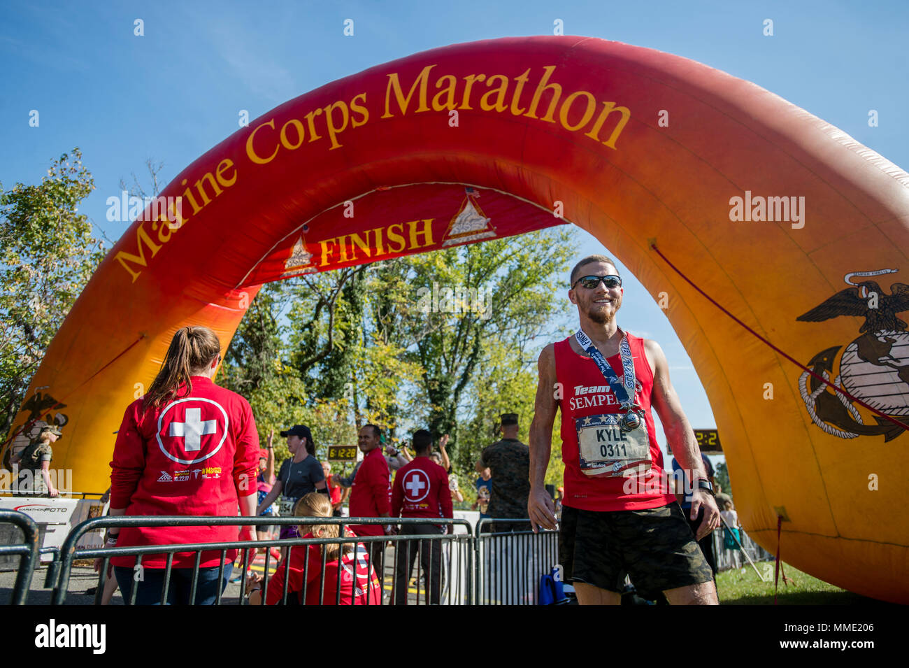 "Medal of Honor recipient, retired U.S. Marine Corps Cpl. Kyle Carpenter, poses for a photo after completing the 42nd Marine Corps Marathon, Arlington, Va., Oct. 22, 2017. Also known as ""The People's Marathon,"" the 26.2 mile race drew roughly 30,000 participants to promote physical fitness, generate goodwill in the community, and showcase the organizational skills of the Marine Corps. (U.S. Marine Corps photo by Lance Cpl. Yasmin D. Perez) Stock Photo"