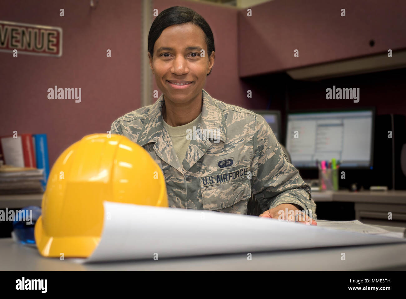 Airman 1st Class Sherry Rhoden, 374th Contracting Squadron contract specialist, checks a project map, Oct. 16, 2017, at Yokota Air Base, Japan. Rhoden was selected as Airlifter of the Week for her dedication to purchasing commodity, services and  construction contracts for the Pacific area of responsibility. (U.S. Air Force Photo by Machiko Arita) - Stock Image