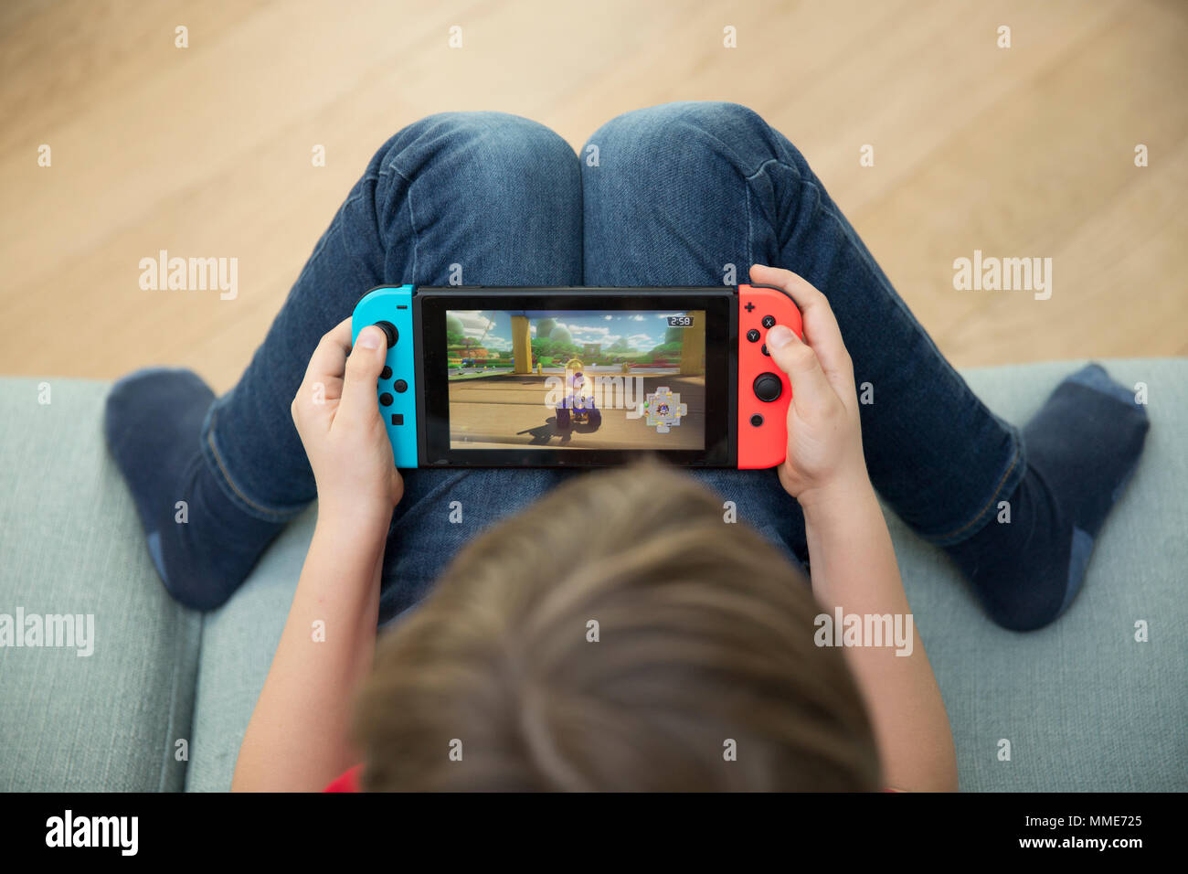 CHILD PLAYING VIDEO GAME - Stock Image