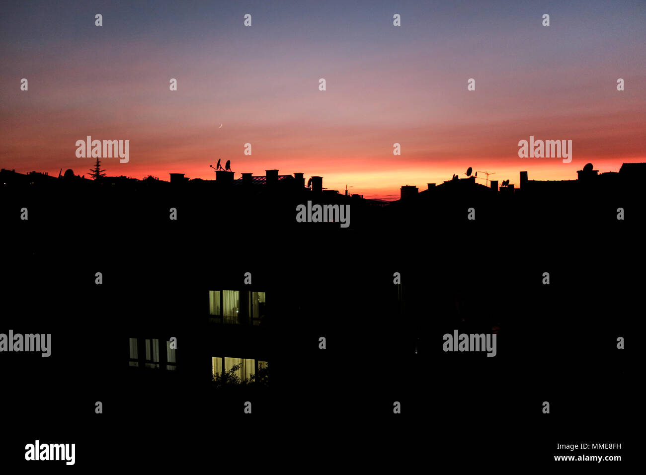 sunset skyscape city town silhouette - Stock Image
