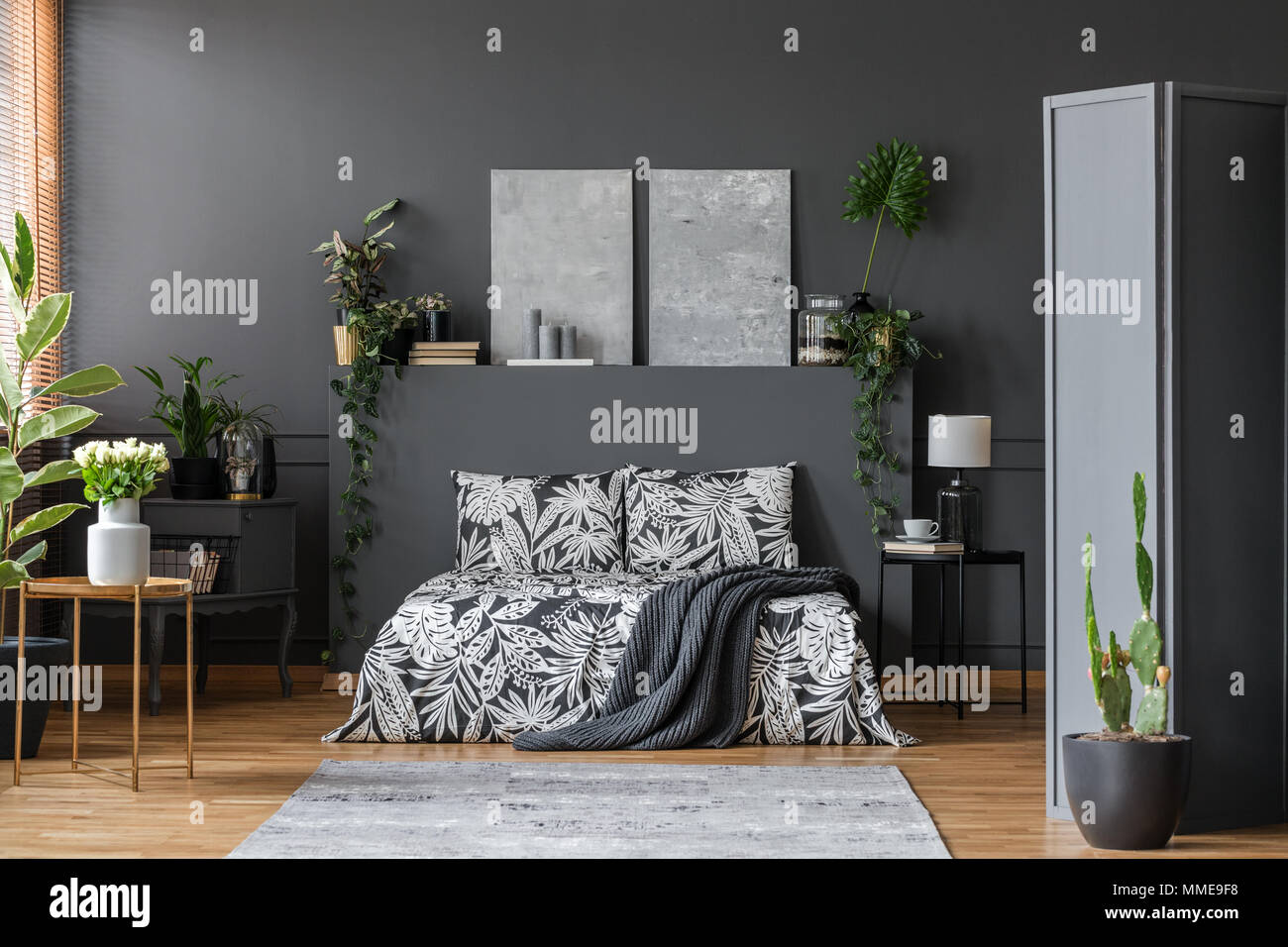 Floral pattern black bedding in a stylish dark gray bedroom interior with plants and elegant furniture & Floral pattern black bedding in a stylish dark gray bedroom ...