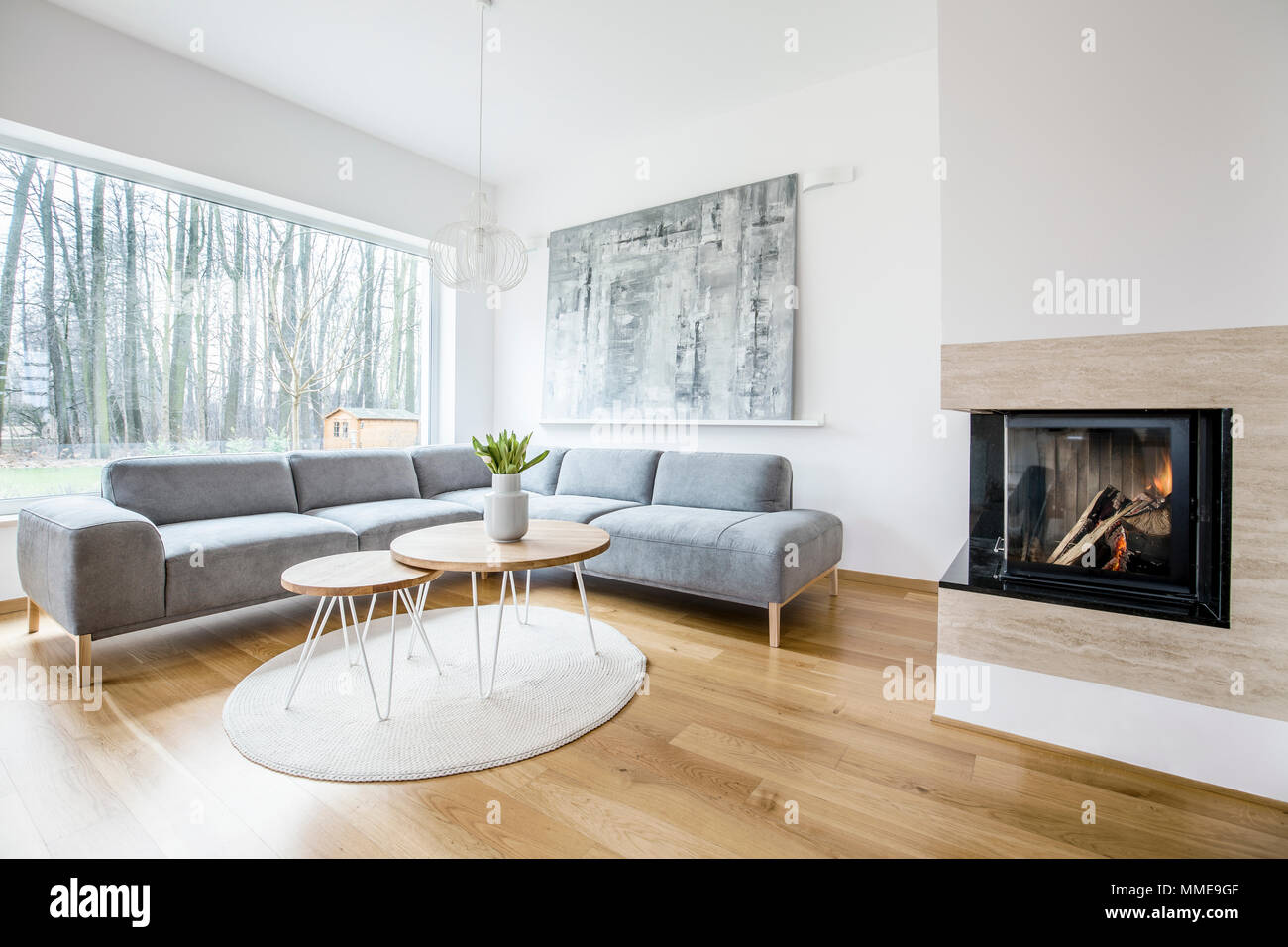 Wooden table on a round rug near sofa in spacious living room ...
