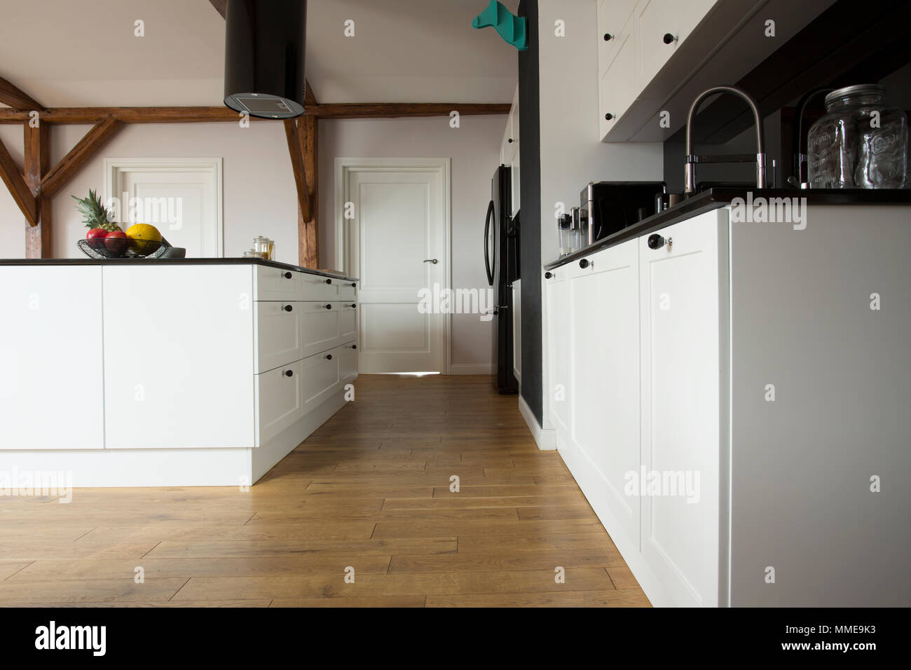 Low Angle View Of A Modern Kitchen Interior With Wooden Floor