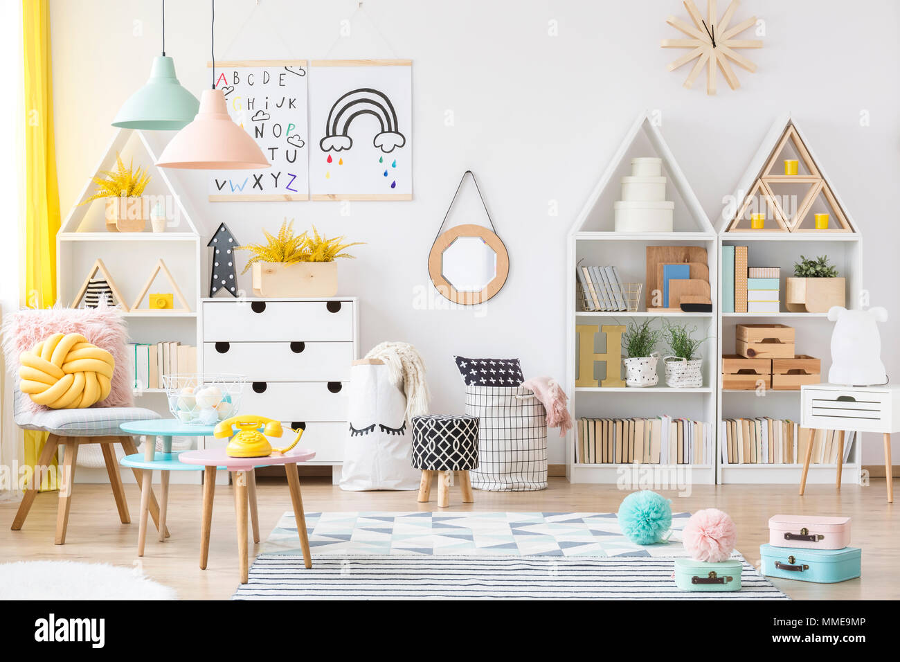 Two Simple Posters Hanging On White Wall In Kids Room Interior With  Material Baskets, Wooden Furniture And Pastel Lamps