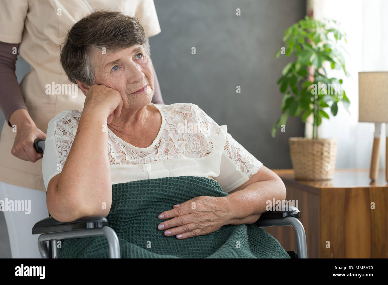 Sad handicapped woman worried about the success of her medical treatment in hospital - Stock Image