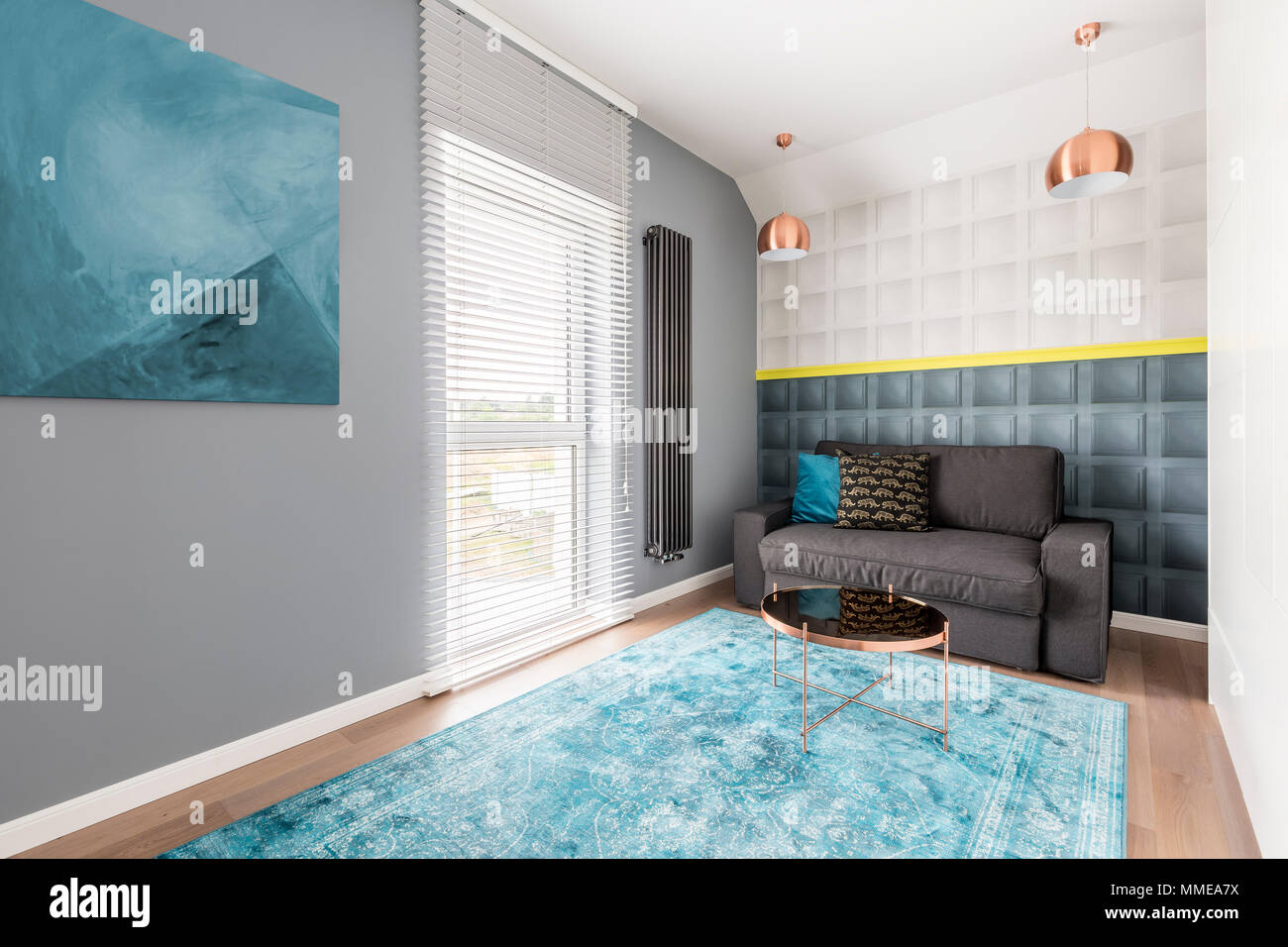 Image of: Contemporary Stylish Room With Gray Couch Blue Abstract Artwork Coffee Table Square Molding And Decorative Pillows Stock Photo Alamy