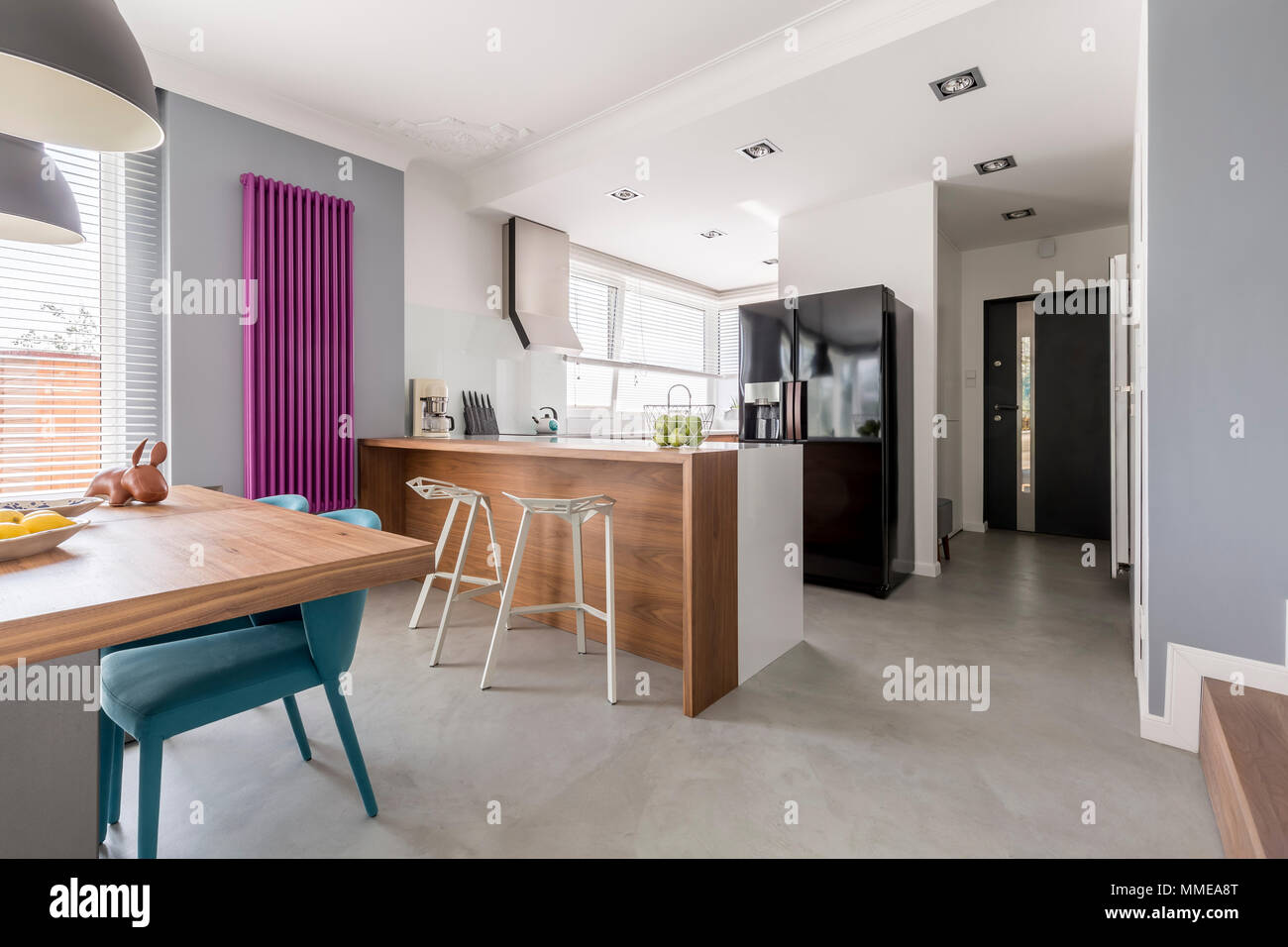 Dining room, kitchen and entrance in contemporary family house ...