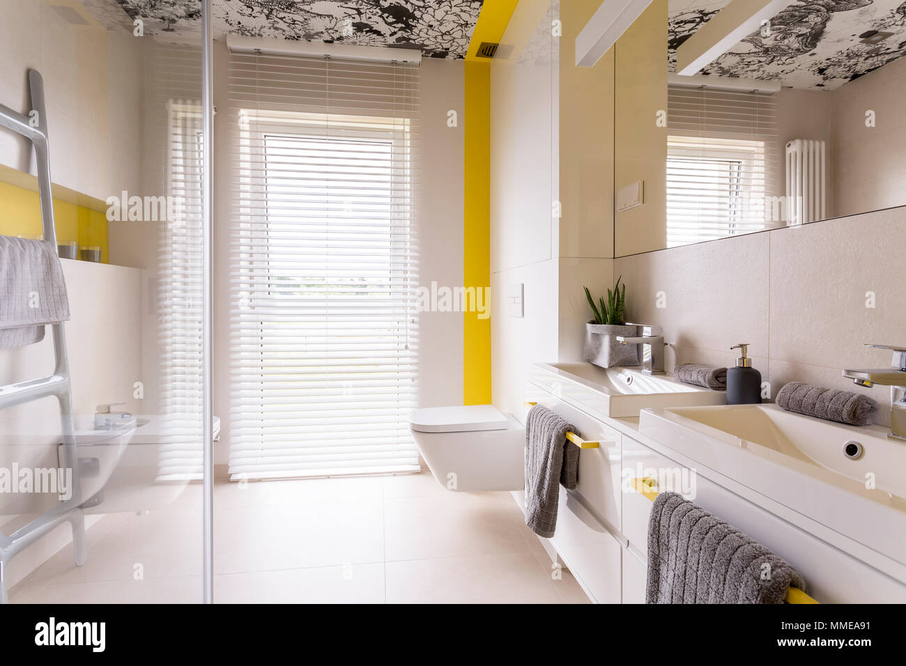 Fresh and bright contemporary bathroom with beige tiles, mirror ...