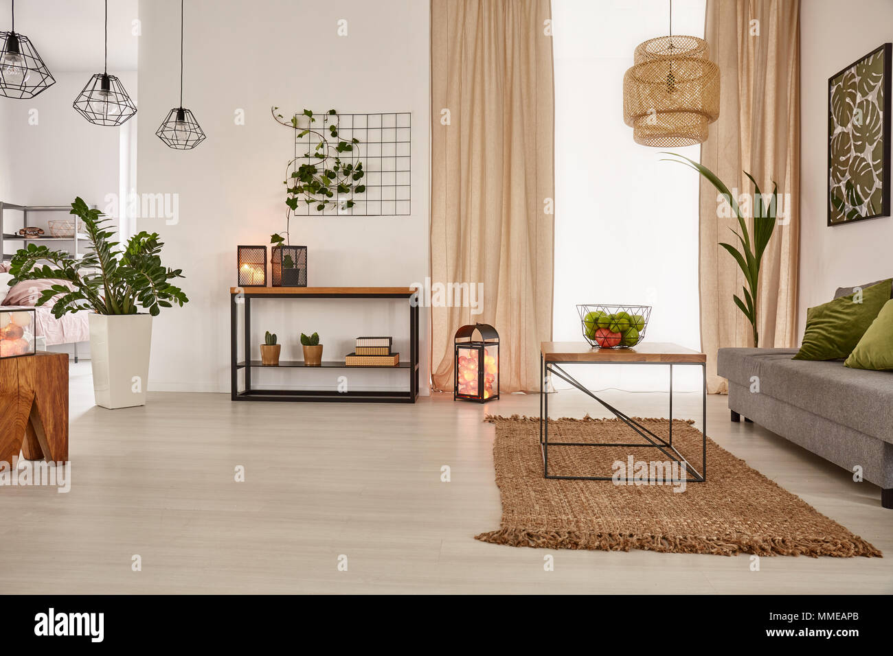 Earth's tones home interior with sofa and table - Stock Image