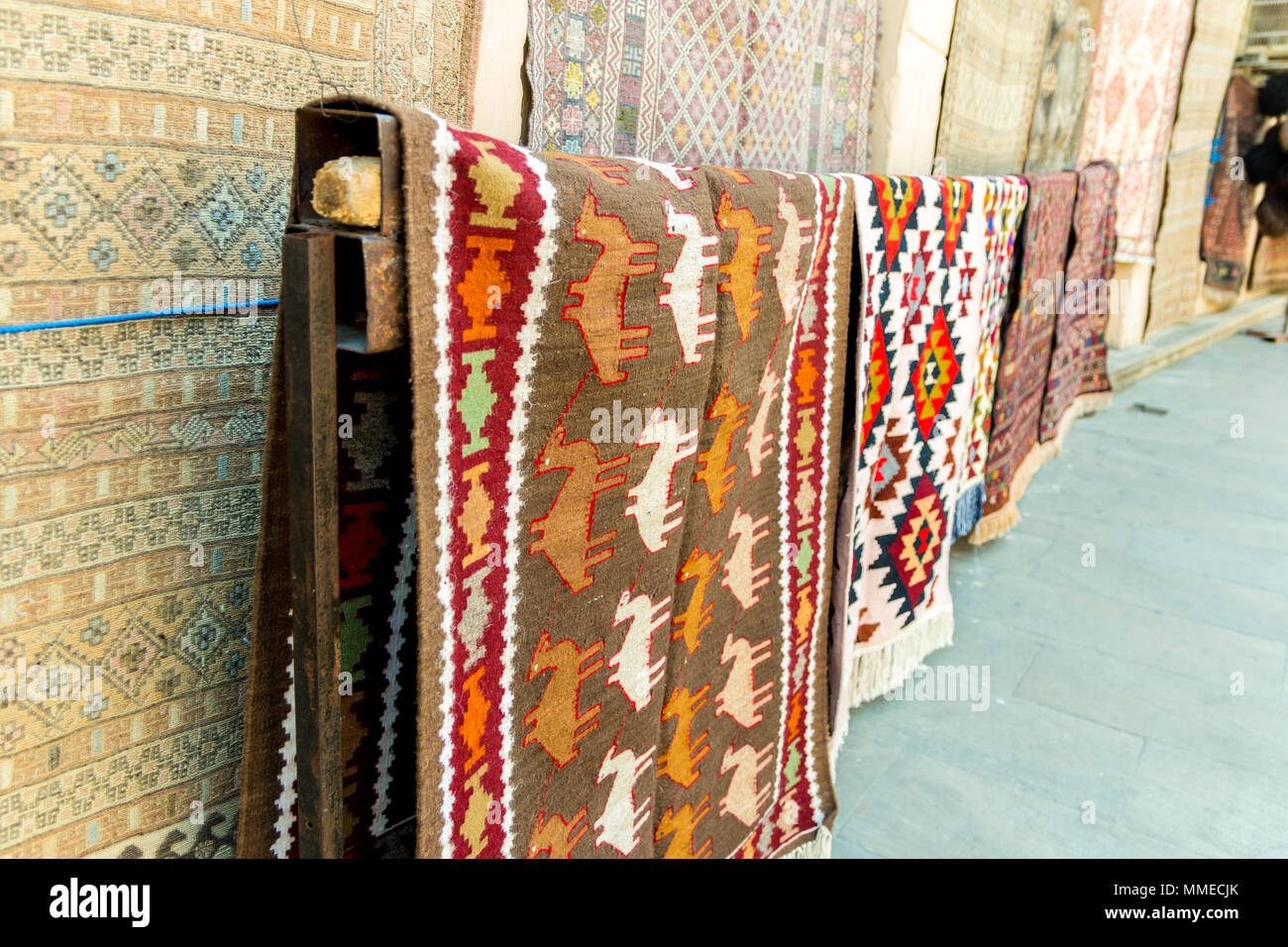 Group of precious ancient colored wool Azeri ancient carpets made by hand in ancient city at Carpet store. - Stock Image