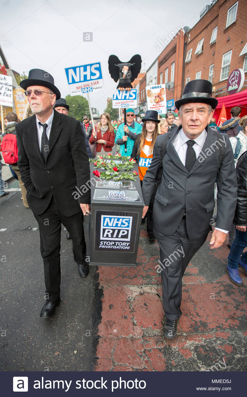 Anti-Austerity march in Manchester where up to 60,000 joined the  demonstration on the opening day of the Conservative Party Conference, voicing opposition to policies including spending & benefit cuts, NHS reforms & restrictions on trade unions. 04/10/2015 - Stock Image