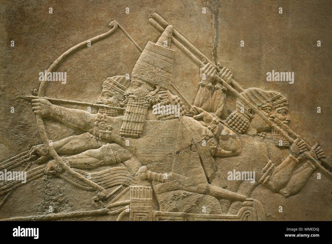 London. England. British Museum. King Ashurbanipal Hunting Lions. Stone wall panel relief, (645-635 BC) from the North Palace of (Room C, Panel 7-8),  - Stock Image