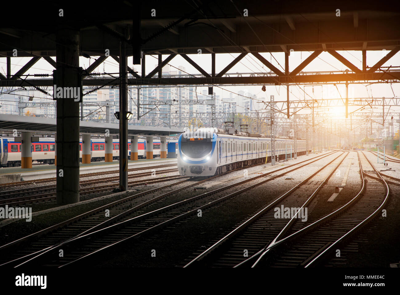 Korea train on railway with skyline at Seoul, South Korea for transportation background - Stock Image