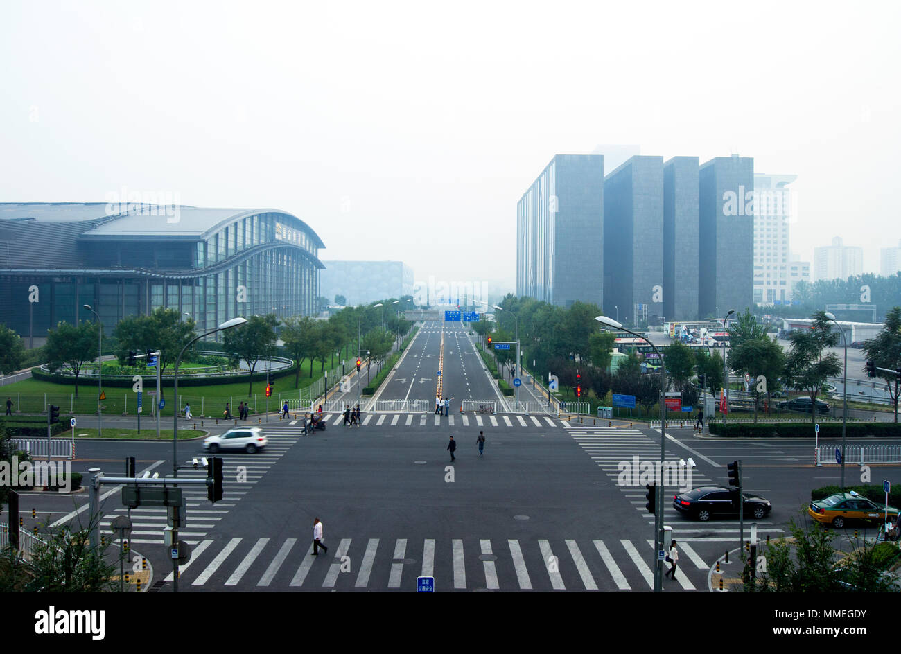 A dull smoggy view from the China National Convention Center in Beijing, China, showing at left the Beijing National Indoor Stadium. - Stock Image
