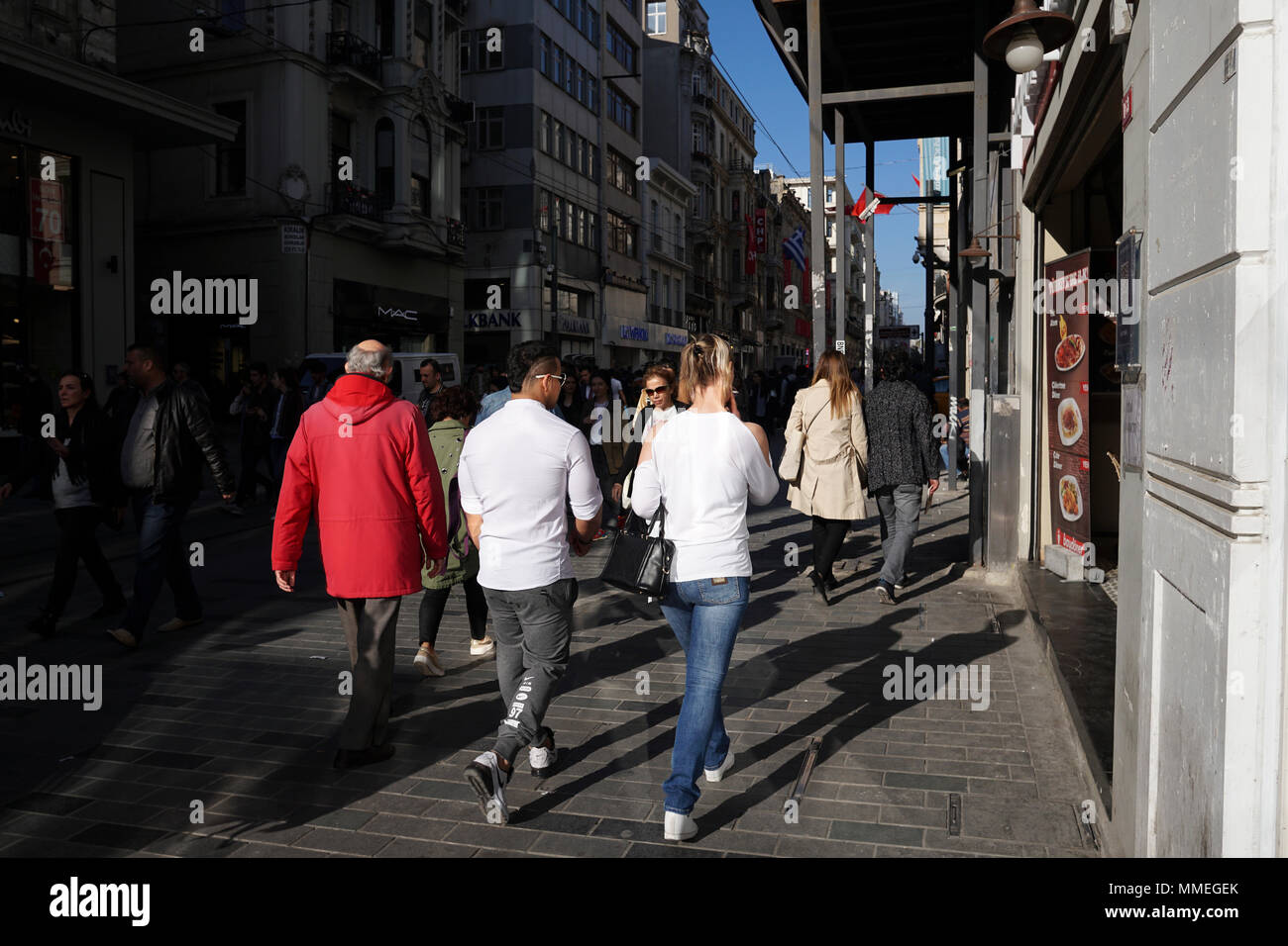 Istanbul, Turkey - April 19, 2018: Turkish people and  tourists are walking at The Istiklal Street, Beyoglu in a sunny springtime day. There are many Stock Photo